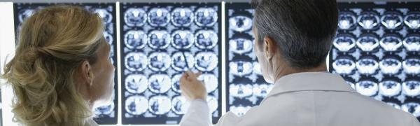 Doctors look at brain scans
